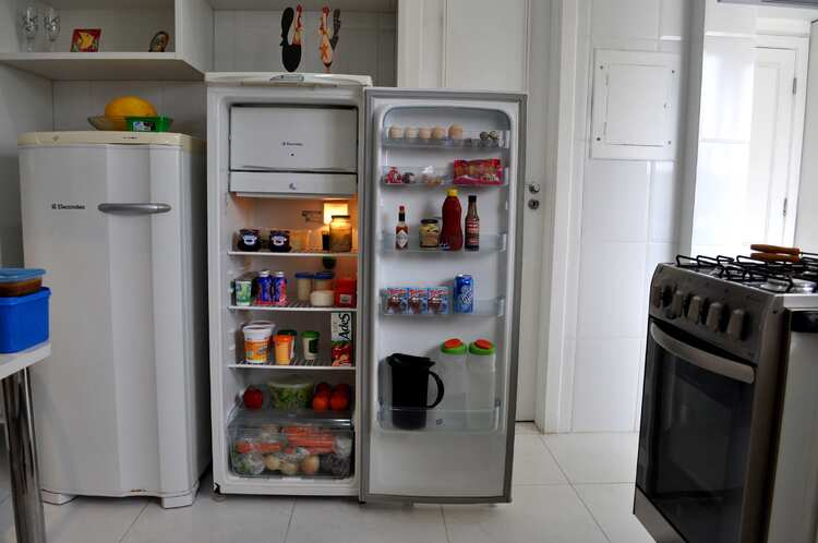 Open Refrigerator on tiled floor