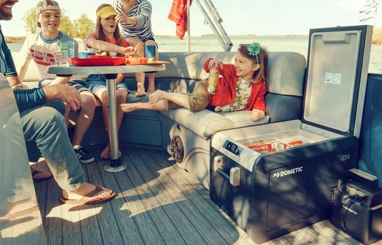 family on boat trip with rv fridge