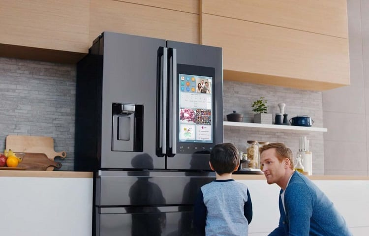 dad with son in front of the fridge