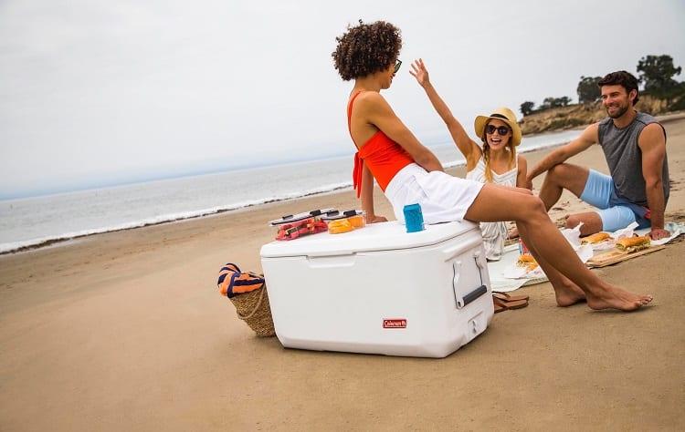 girl sitting on cooler