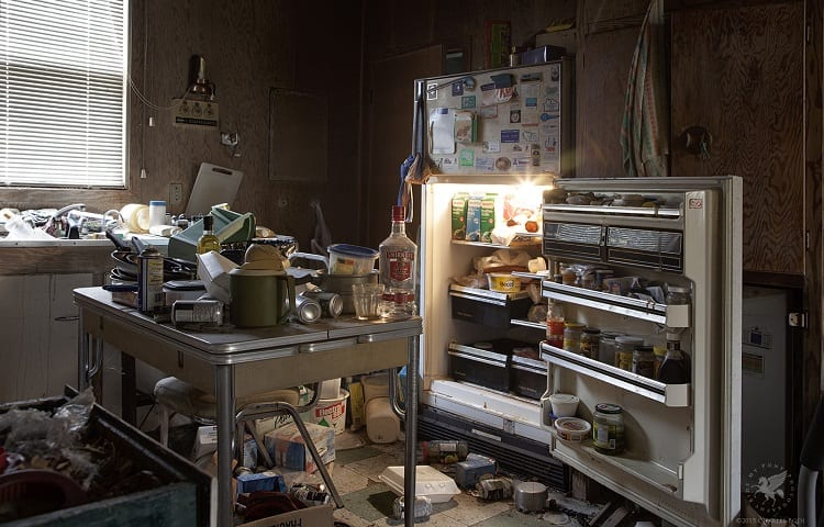 kitchen mess and opened door on fridge