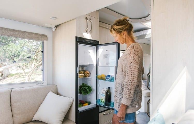 woman opening rv fridge